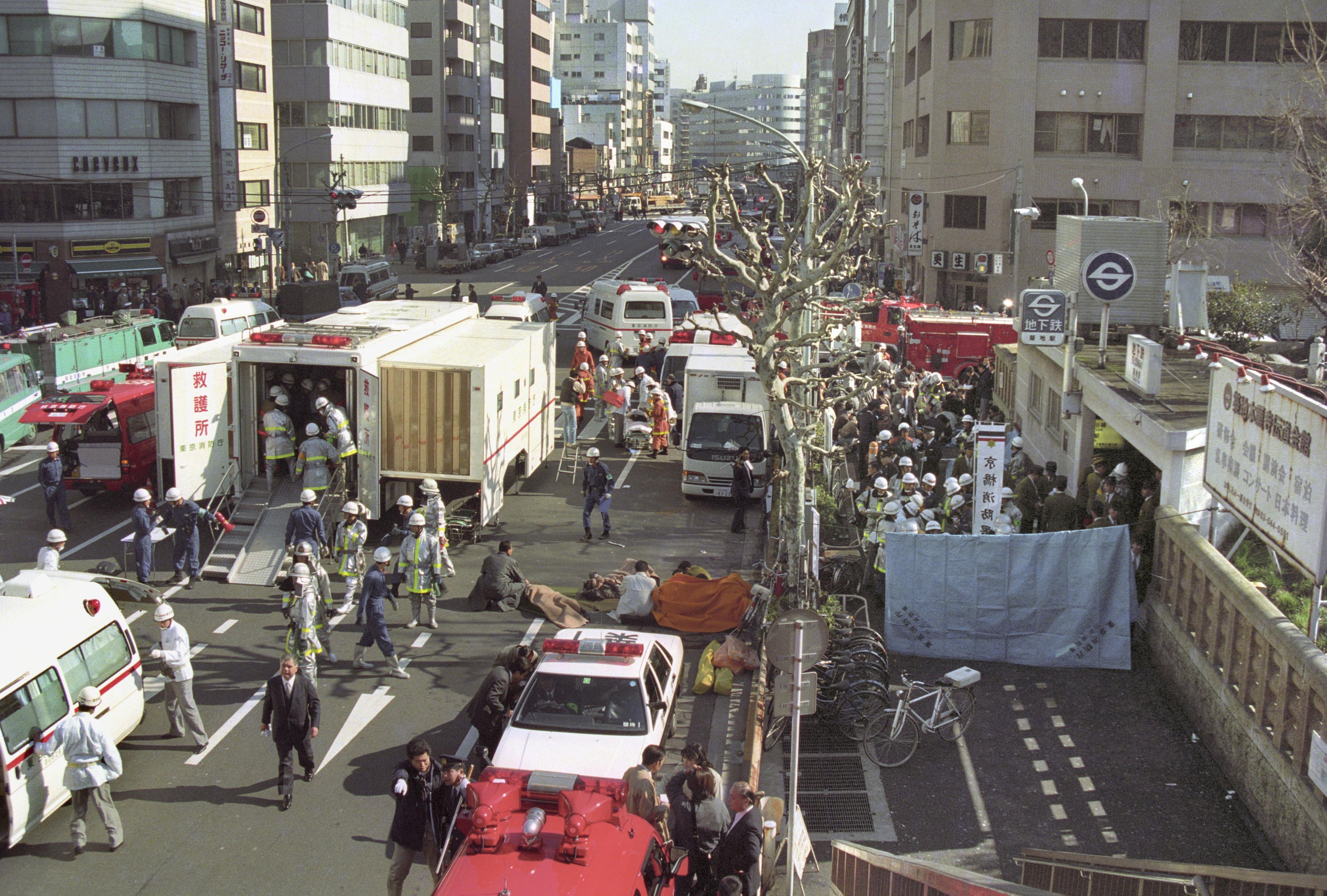 The injured of the deadly gas attack are treated by rescue workers near Tsukiji subway station in Tokyo