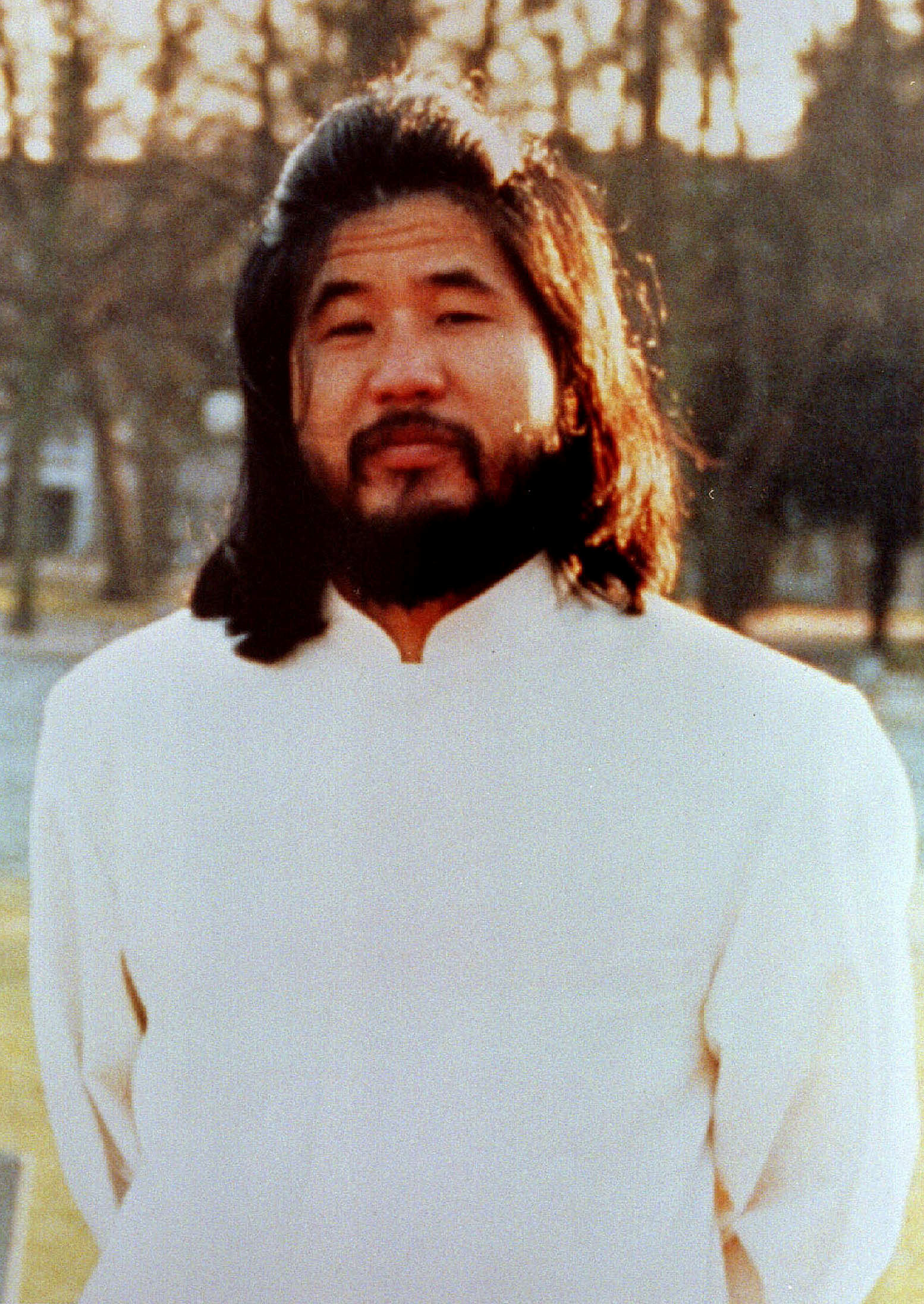 Former leader of Japanese doomsday cult Aum Shinri Kyo Shoko Asahara poses in this undated file photo.