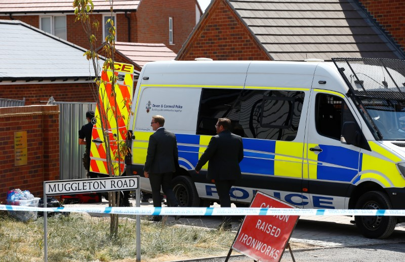Police investigators arrive at the site of a housing estate on Muggleton Road, after it was confirmed that two people had been poisoned with the nerve-agent Novichok, in Amesbury