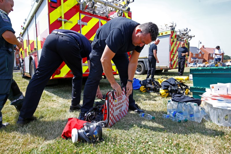 Fire and Rescue Service personel prepare safety equipment at the site of a housing estate on Muggleton Road, after it was confirmed that two people had been poisoned with the nerve-agent Novichok, in Amesbury