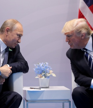 Russia's President Putin talks to U.S. President Trump during their bilateral meeting at the G20 summit in Hamburg