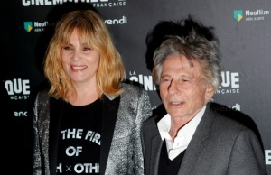 "French actor Emmanuelle Seigner and director Roman Polanski pose together prior to the screening of Polanski's movie ""D'apres une histoire vraie"" at the Cinematheque in Paris"