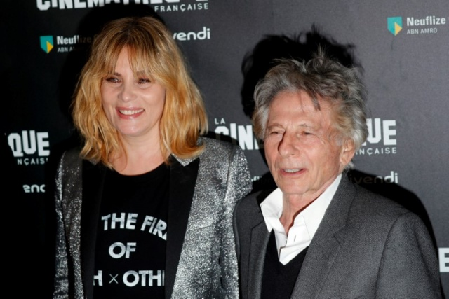 French actor Emmanuelle Seigner and director Roman Polanski pose together prior to the screening of Polanski's movie
