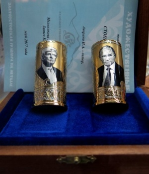 A souvenir depicting Russian President Vladimir Putin and American President Donald Trump is seen at the airport in Saint Petersburg, Russia, July 5, 2018.