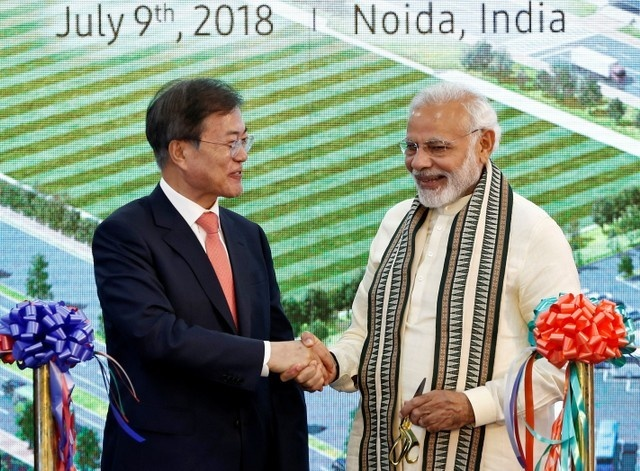 South Korean President Moon Jae-in and Indian Prime Minister Narendra Modi shake hands after inaugurating the Samsung Electronics smartphone manufacturing facility in Noida