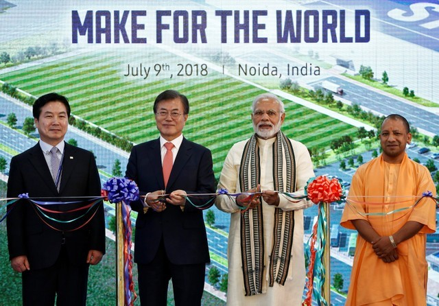 South Korean President Moon Jae-in, Indian Prime Minister Narendra Modi and Yogi Adityanath, Chief Minister of Uttar Pradesh state pose as they inaugurate the Samsung Electronics smartphone manufacturing facility in Noida