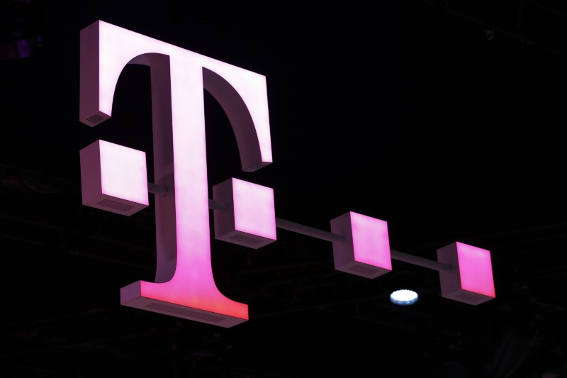 A Deutsche Telekom logo is seen at the Mobile World Congress in Barcelona