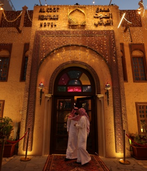 Visitors are seen at the entrance of Al Koot Heritage Hotel in Al Ahsa
