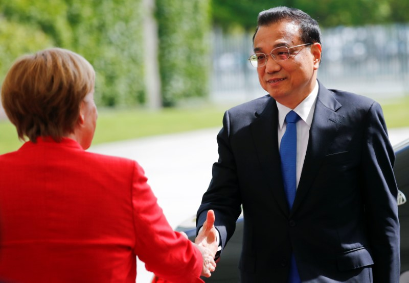 German Chancellor Angela Merkel shakes hands with Chinese Prime Minister Li Keqiang at the chancellery in Berlin