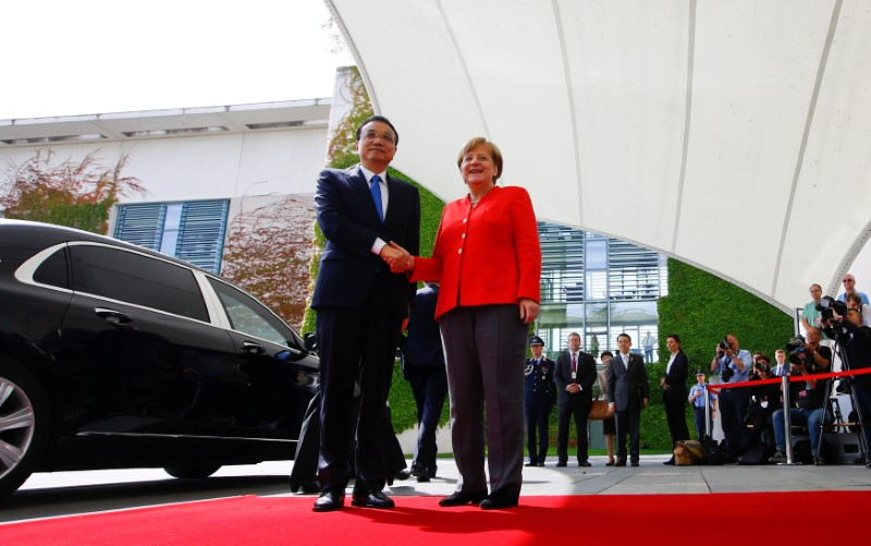 German Chancellor Angela Merkel and Chinese Prime Minister Li Keqiang shake hands at the chancellery in Berlin