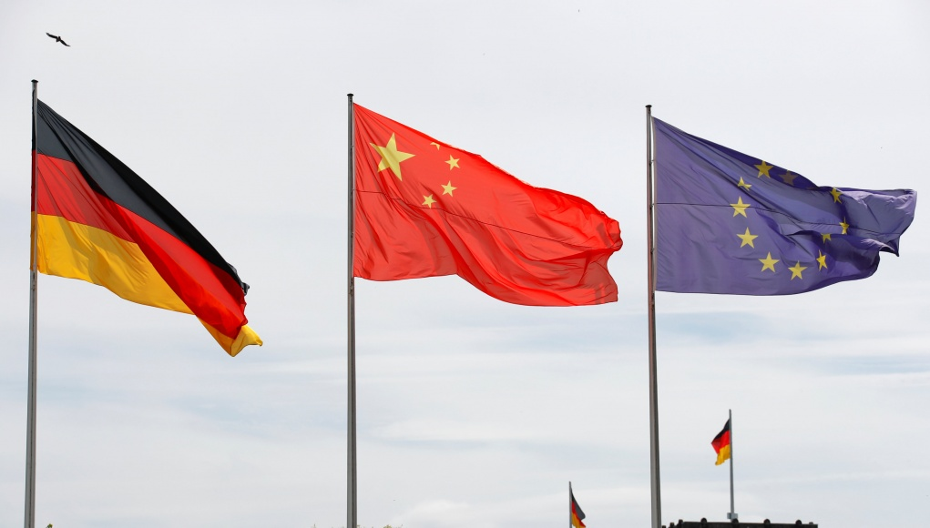 German, Chinese and EU flags flutter during the visit of Chinese Prime Minister Li Keqiang at the chancellery in Berlin