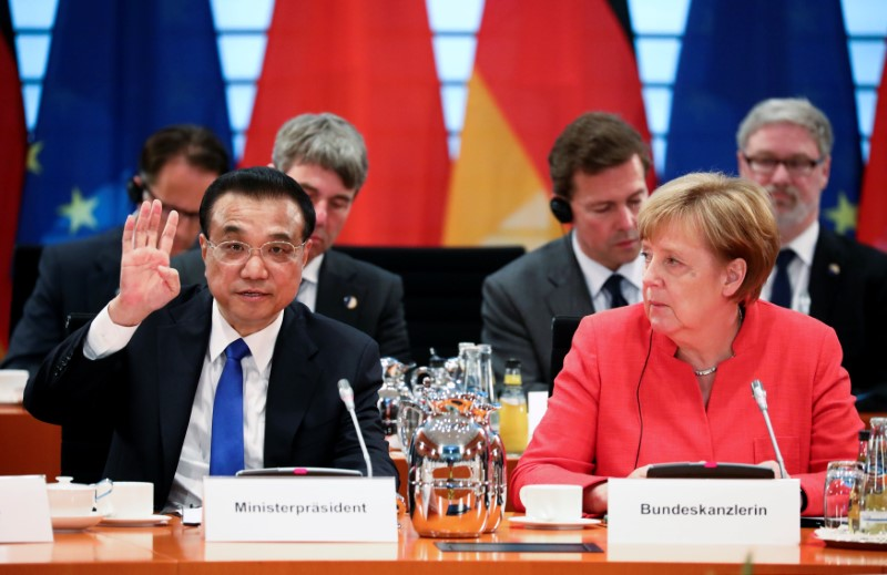 German Chancellor Angela Merkel and Chinese Prime Minister Li Keqiang attend the plenary session at the chancellery in Berlin
