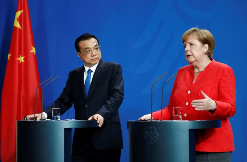 German Chancellor Angela Merkel and Chinese Prime Minister Li Keqiang hold a news conference at the chancellery in Berlin