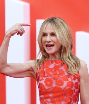 Actress Holly Hunter poses for photographs as she arrives at the UK premiere of Incredibles 2 in London