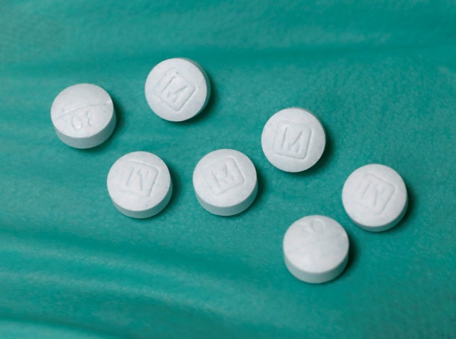 A pharmacist holds prescription painkiller Oxycodone Hydrochloride, 30mg pills, made by Mallinckrodt