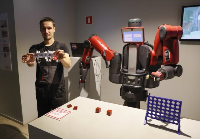 Robot Baxter attempts to predict the result of the soccer World Cup semi-final between France and Belgium during an event in Moscow
