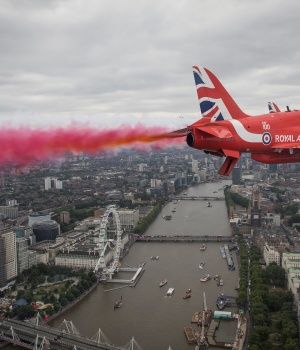 Members of the Red Arrows Royal Air Force Aerobatic Team fly over London, heading for Buckingham Palace, to mark the centenary of the Royal Air Force in central London