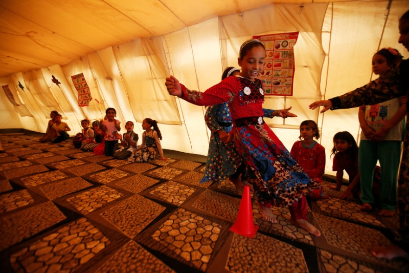 Iraqi children take part in activities at Debaga camp for the displaced on the outskirts of Erbil