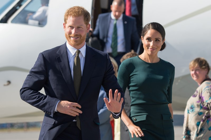 Britain's Prince Harry and his wife Meghan, the Duke and Duchess of Sussex, arrive at Dublin City Airport for a two-day visit to Dublin