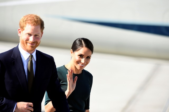 Britain's Prince Harry and his wife Meghan, the Duke and Duchess of Sussex, are greeted by the Taoiseach Leo Varadkar, as they arrive for a two-day visit to Dublin