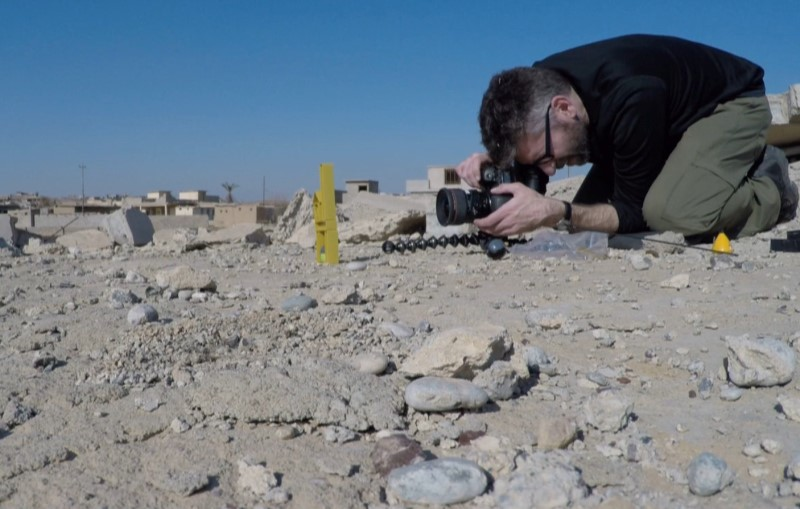 U.S. photographer Brian McCarty is seen working in Mosul