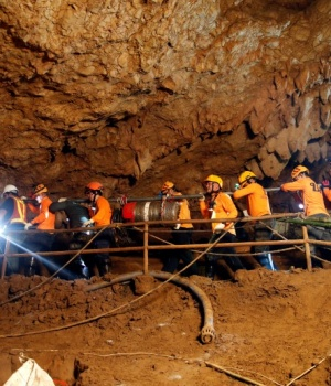 Rescue workers take out machines after 12 soccer players and their coach were rescued in Tham Luang cave complex in the northern province of Chiang Rai