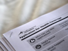 Applications are seen at a rally held by supporters of the Affordable Care Act in Jackson Mississippi
