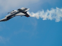 A Lockhead Martin F-16 Fighting Falcon flies on the second day of the Farnborough International Airshow in south England