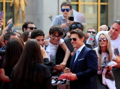 "Cast member Tom Cruise poses for cinema fans as he arrives for the world premiere of ""Mission: Impossible - Fallout"" in Paris"