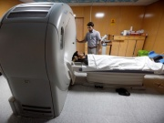 A patient receives a CT scan at an Amiri private hospital in Kabul