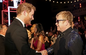 Britain's Prince Harry greets Elton John after the Royal Variety Performance at the Albert Hall in London