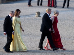 U.S. President Donald Trump and First Lady Melania Trump are met by British Prime Minister Theresa May and her husband Philip at Blenheim Palace, where they are attending a dinner with other specially invited guests and business leaders, near Oxford