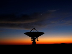 Dawn breaks over a radio telescope dish of the KAT-7 Array pointing skyward at the proposed South African site for the Square Kilometre Array (SKA) telescope near Carnavon in the country's remote Northern Cape province