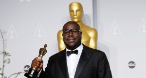 """""""12 Years a Slave"""" director Steve McQueen poses with his best picture award at the 86th Academy Awards in Hollywood"""
