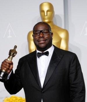 """12 Years a Slave"" director Steve McQueen poses with his best picture award at the 86th Academy Awards in Hollywood"