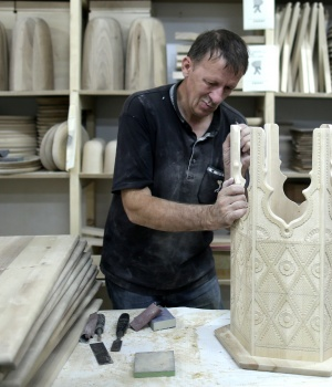 A worker handles wood parts for furniture at the Zanat company in Konjic