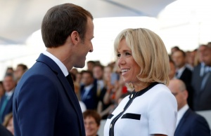 French President Emmanuel Macron and his wife Brigitte Macron attend the traditional Bastille Day military parade on the Champs-Elysees avenue in Paris