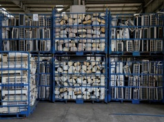 Air conditioners, about to be recycled, are seen in a warehouse in Guiyu