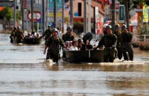 Japan Self-Defence Force soldiers rescue people from a flooded area in Mabi town in Kurashiki