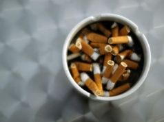 An ash tray with cigarette butts is pictured in Hinzenbach