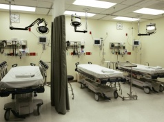 Beds lie empty in emergency room of Tulane University Hospital in New Orleans
