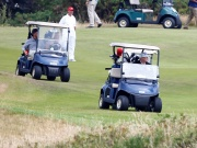 U.S. President Donald Trump drives his golf buggy at his golf resort, in Turnberry,