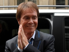 Singer Cliff Richard arrives at the High Court for judgement in the privacy case he brought against the BBC, in central London