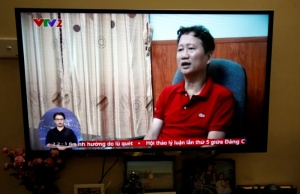 An image of Vietnamese former oil executive Trinh Xuan Thanh is seen on a TV screen on state-run television VTV,