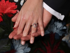 Britain's Princess Eugenie wears a ring containing a padparadscha sapphire surrounded by diamonds as she and Jack Brooksbank pose in the Picture Gallery after they announced their engagement, at Buckingham Palace, London