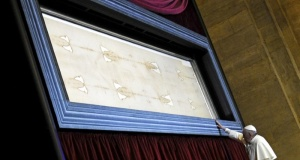 Pope Francis touches the Shroud of Turin during a two-day pastoral visit in Turin