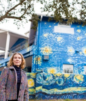 Nancy Nembhauser poses in front of the house in Mount Dora, Florida