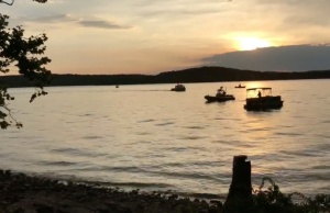 "Rescue personnel work after an amphibious ""duck boat"" capsized and sank, at Table Rock Lake near Branson, Stone County"