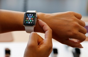 A woman tries a new Apple Watch Series 3 Cellular model after it goes on sale at the Apple Store in Tokyo's Omotesando shopping district