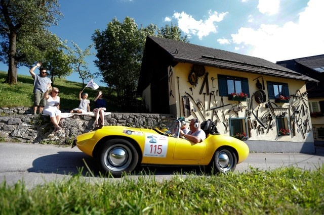 Participants drive their car during the Ennstal Classic Car rally in the village of Puergg